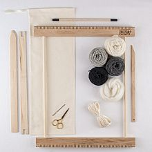 A Weaving Frame & Weaving Kit (14 Inch - Gray).  Everything you need to make your own woven wall hanging.